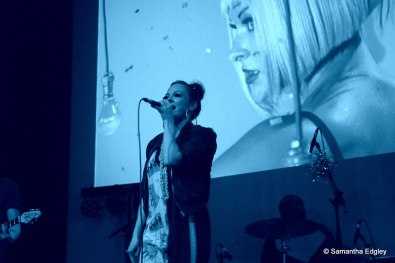 Mila Falls live on stage at her video launch party