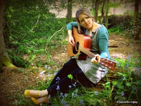 Rachel playing guitar at Highgate Woods
