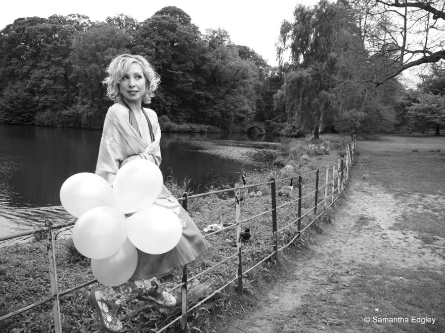 Kate by the lake at Hampstead Heath with balloons
